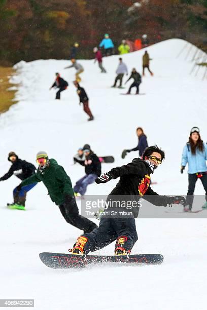Visitors enjoy snowboarding as the ski resort 'Utopia Saioto' opens with the artificial snow on November 13 2015 in Hitahiroshima Hiroshima Japan