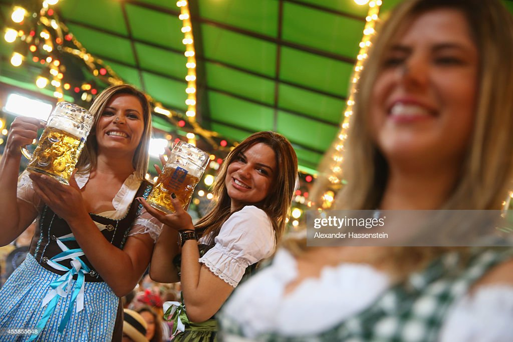 Visitors enjoy the atmosphaere at Augustiner Beer tent after the Parade of Costumes and Riflemen on the second day of the 2014 Oktoberfest at...