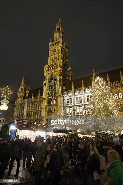 Visitors enjoy the atmosphere at the annual Christmas market on Marienplatz square on the market's opening day on November 27 2014 in Munich Germany...