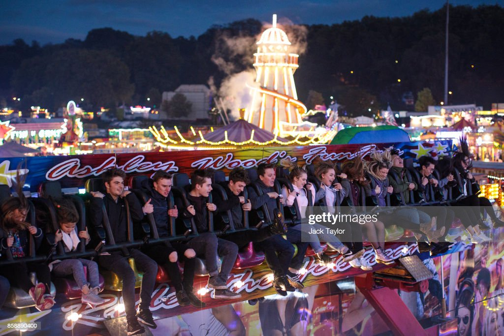 Visitors enjoy the attractions at the Nottingham Goose Fair in the Forest Recreation Ground on October 7, 2017 in Nottingham, England. The annual goose fair hosts over 500 attractions for thrill seekers including fun fair classics such as bumper cars, carousels and helter-skelters. The fair is thought to be over 700 years old and its name comes from its origins as a market in the forest grounds where thousands of geese were sold each year.
