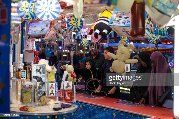 Visitors enjoy the attractions at the Nottingham Goose Fair in the Forest Recreation Ground on October 7 2017 in Nottingham England The annual goose...
