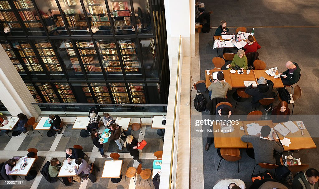 Visitors enjoy the cafe at The British Library on April 5, 2013 in London, England. The British Library and four other organisations have been given the right to archive the digital world from today. An estimated billion pages a year will be available for researchers to access through the new archive.