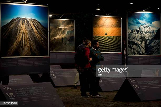 PUBLICATION A visitors enjoy the Earth from Above exhibition by French photographer Yann ArthusBertrand displayed at the Art Museum of Sao Paulo on...