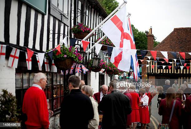 Visitors enjoy the Ightham medieval Coxcombe Fair to celebrate Queen Elizabeth II's Diamond Jubilee on June 03 2012 in Ightham England For only the...