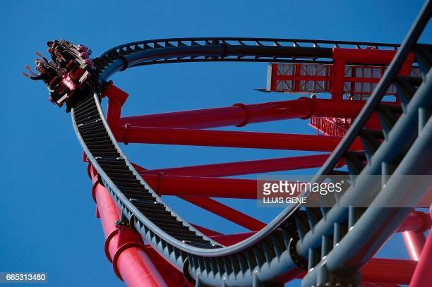 Visitors enjoy the main attraction 'Red Force' the fastest vertical accelerator in Europe during the opening day of Ferrari Land at the PortAventura...