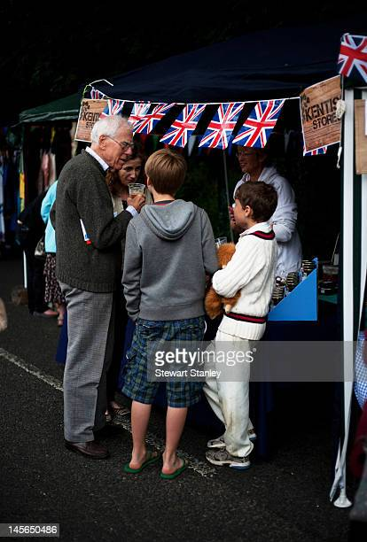 Visitors enjoy the stalls at the Ightham medieval Coxcombe Fair to celebrate Queen Elizabeth II's Diamond Jubilee on June 03 2012 in Ightham England...