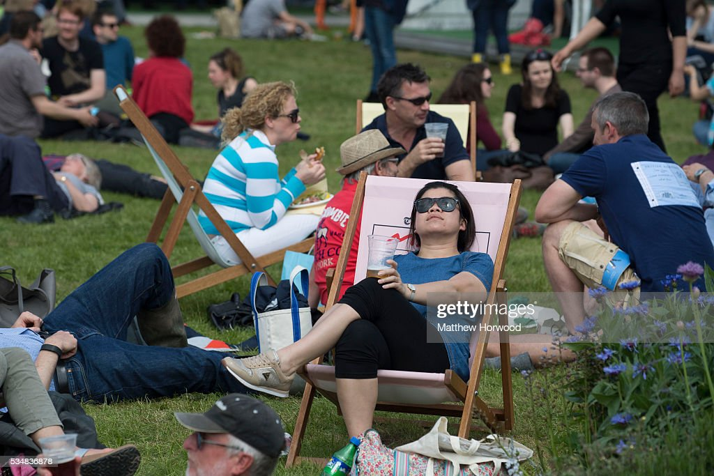 Visitors enjoy the sun during the warm summer weather in Hay-on-Wye during the 2016 Hay Festival on May 28, 2016 in Hay-on-Wye, Wales. The Hay Festival is an annual festival of literature and arts now in its 29th year.