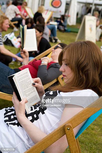 Visitors enjoy the sunshine at The Guardian Hay Festival 2007 held at Hay on Wye on June 2 2007 in Powys Wales The festival runs until June 3