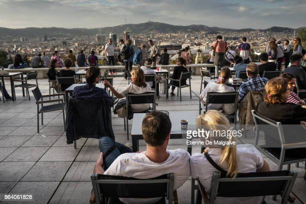 Visitors enjoy the terrace of the National Art Museum of Catalonia as the Spanish government is to take steps to suspend Catalonia's autonomy by...
