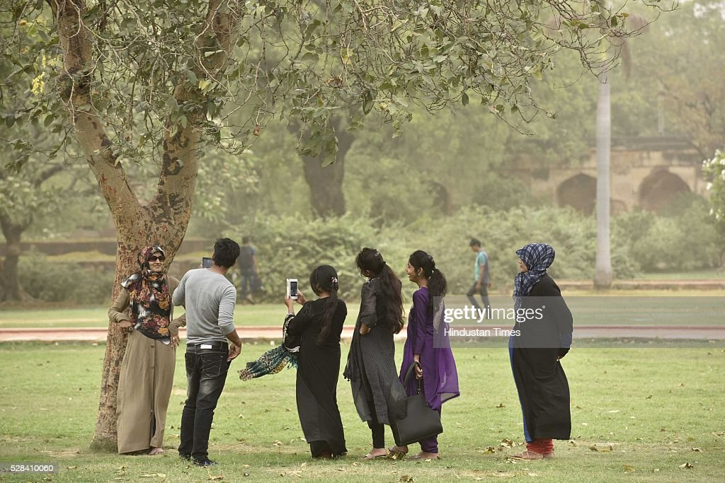 Visitors enjoying the pleasant weather at Humayun Tomb, on May 4, 2016 in New Delhi, India. The Met Office has predicted light rains for the day. The maximum temperature is expected to hover around 40 degrees Celsius.