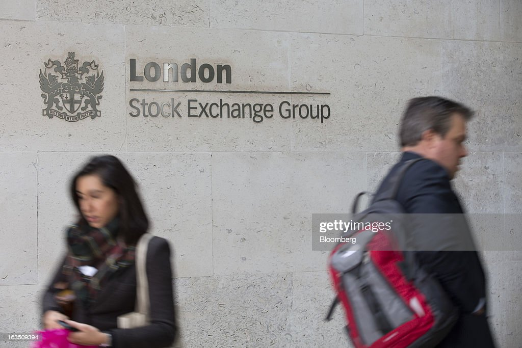 Visitors enter and exit the London Stock Exchange Group Plc's (LSE) headquarters in London, U.K., on Monday, March 11, 2013. European stocks fell from a 4 1/2-year high as Fitch Ratings downgraded Italy and China's retail sales and industrial output missed forecasts. Photographer: Jason Alden/Bloomberg via Getty Images