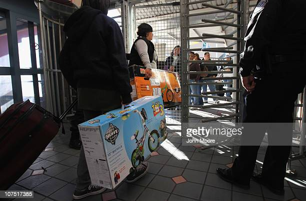 Visitors enter Mexico with goods purchased in the United States at the USMexico border crossing on December 10 2010 at Nogales Arizona Despite...