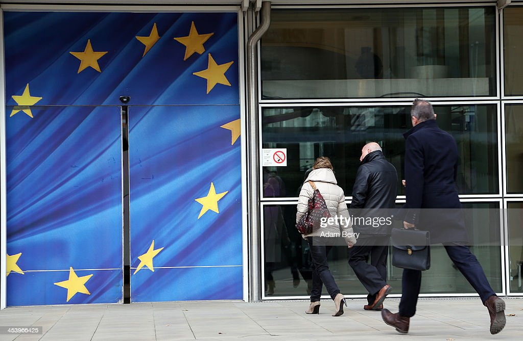 Visitors enter the Berlaymont building of the European Commission (EC) on December 6, 2013 in Brussels, Belgium. The European Commission is responsible for the implementation and maintenance of the execution of the European Union's policies.