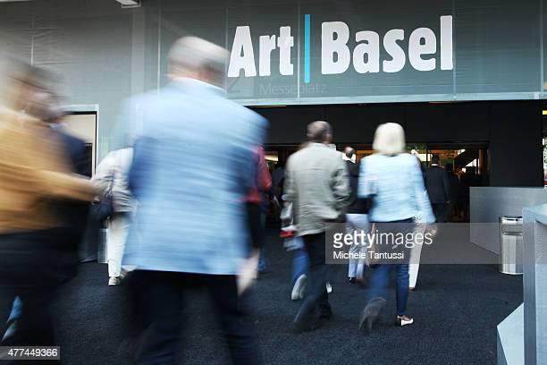 Visitors enter the expositions building during the VIP opening day at Art Basel on June 17 2015 in Basel Switzerland