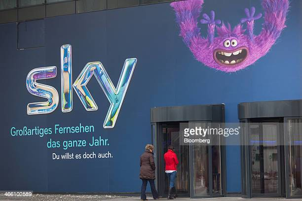 Visitors enter the German headquarters of Sky Deutschland AG in Unterfoehring Germany on Friday Jan 31 2014 BSkyB has a growing subscriber base and...