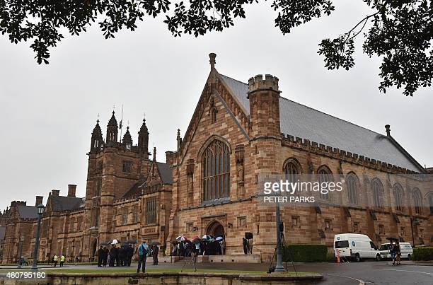 Visitors enter the Great Hall at the University of Sydney for the memorial service of Katrina Dawson in Sydney on December 23 2014 Dawson was killed...