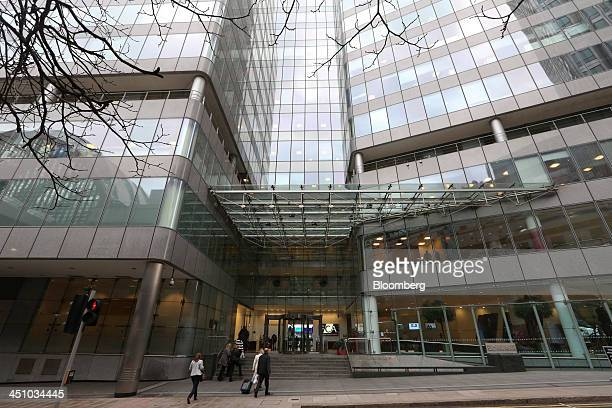 Visitors enter the headquarters of the Financial Conduct Authority in the Canary Wharf business district in London UK on Thursday Nov 21 2013 The FCA...