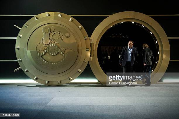 Visitors enter the vault shapped Emporio Armani booth during Baselworld on March 16 2016 in Basel Switzerland Held annually Baselworld is the most...