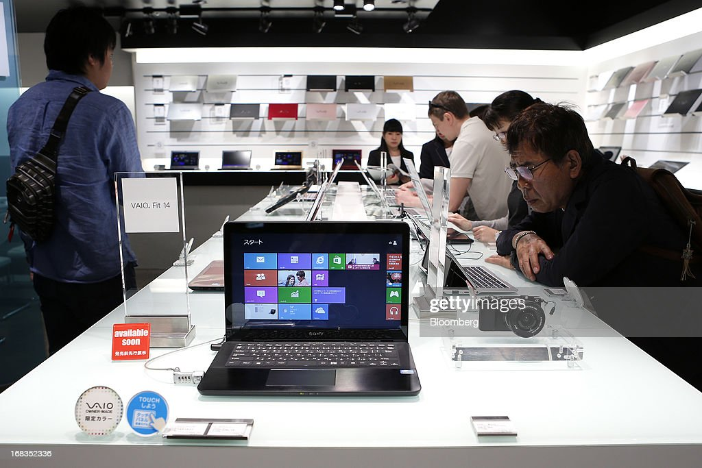 Visitors examine Sony Corp. Vaio laptop computers displayed at the company's showroom in Tokyo, Japan, on Thursday, May 9, 2013. Sony forecast a smaller-than-expected annual profit as its Xperia smartphones and Bravia TVs struggle to regain market share from Apple Inc. and Samsung Electronics Co. Photographer: Kiyoshi Ota/Bloomberg via Getty Images