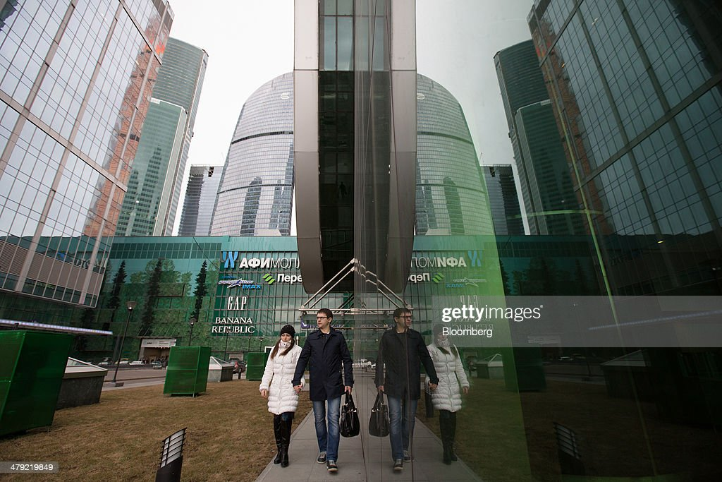 Visitors exit the Afimall shopping and entertainment complex at the Moscow International Business Center, also known as 'Moscow City,' in Moscow, Russia, on Sunday, March 16, 2014. The U.S. and the European Union warned Russia not to annex Crimea after a referendum in the southern Ukrainian region, setting the stage for sanctions on Russia in the worst diplomatic standoff since the Cold War. Photographer: Andrey Rudakov/Bloomberg via Getty Images