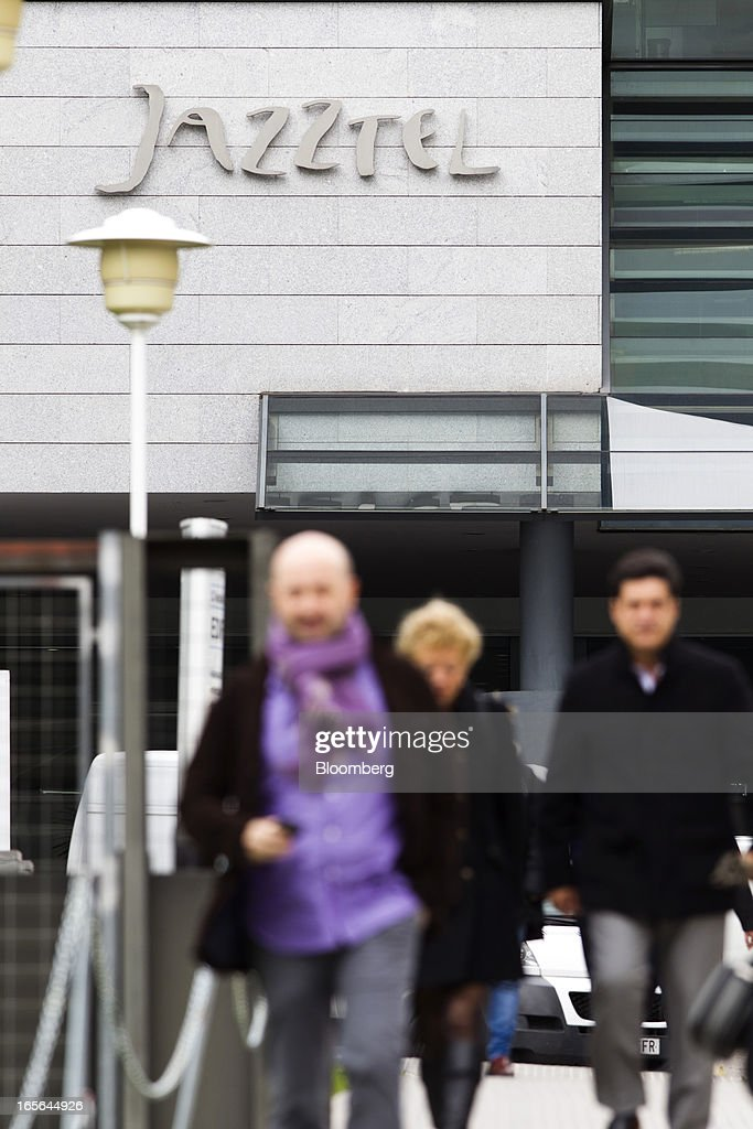 Visitors exit the offices of Jazztel Plc in Alcobendas, Spain, on Thursday, April 4, 2013. Jazztel almost doubled its share of the Spanish broadband market from 2009 to 2012 as it focused mostly on the fixed-telephone business through a reliable and affordable product that has gained popularity among debt-strapped Spaniards. Photographer: Angel Navarrete/Bloomberg via Getty Images