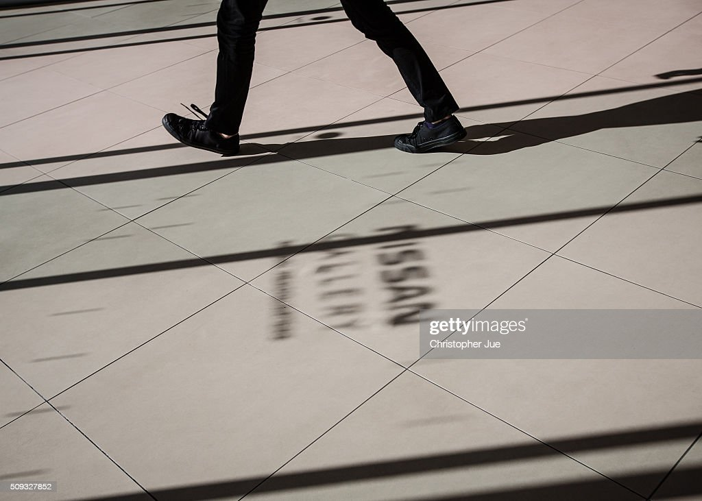 A visitors exits the Nissan showroom headquarters on February 10, 2016 in Tokyo, Japan. Nissan Motor Co., Ltd., announced the financial results for the third quarter of fiscal year 2015 ending March 31, 2016. The net revenues resulted in 8.9430 trillion yen, the operating profit, 587.5 billion yen, and the net income 452.8 billion yen, For the April-December 2015 period, Nissan sold a total of 3,891,000 vehicles globally.
