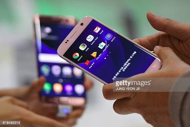 Visitors experience Samsung Galaxy S7 and S7 Edge devices during the Korea Electronics Grand Fair at an exhibition hall in Seoul on October 27 2016...