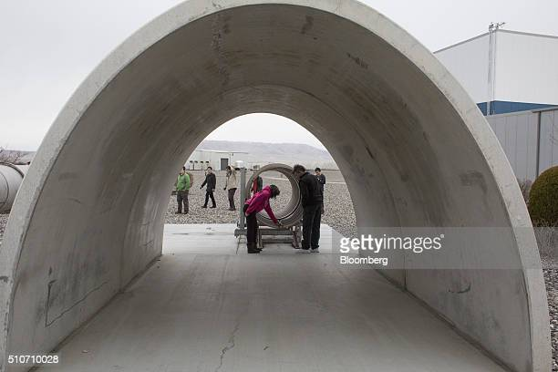 Visitors explore models of the two vacuum chambers measuring four kilometers in length and built to contain lasers at the Laser Interferometer...