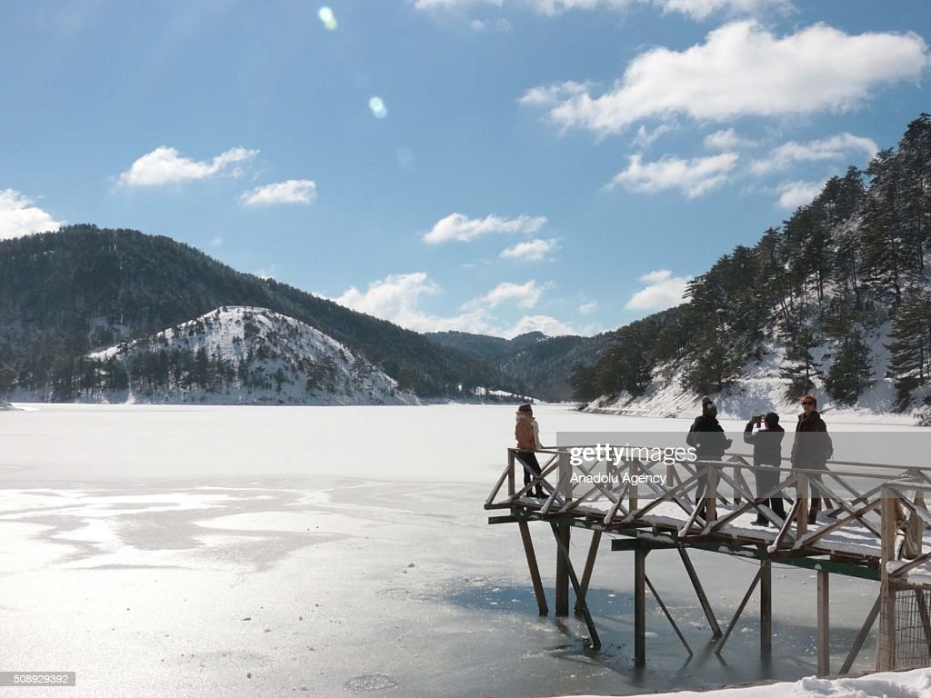 Visitors explore Sunnet Lake Natural Park during winter season in Bolu province of Turkey on February 7, 2016.