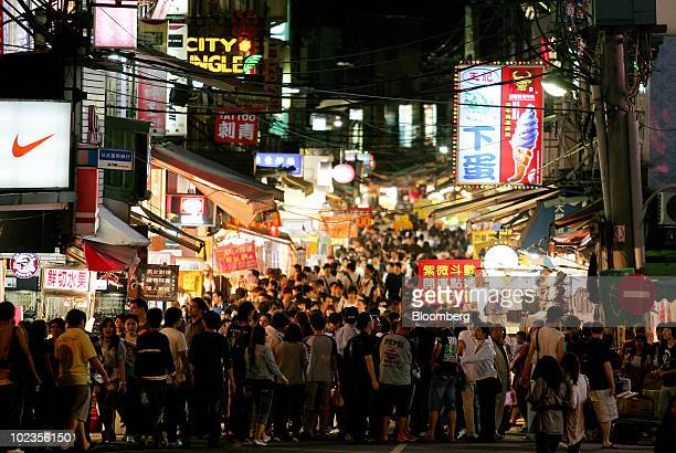 Visitors fill the street of a night market in Taipei Taiwan on Saturday May 8 2010 About 54 million Chinese may travel abroad this year and a...