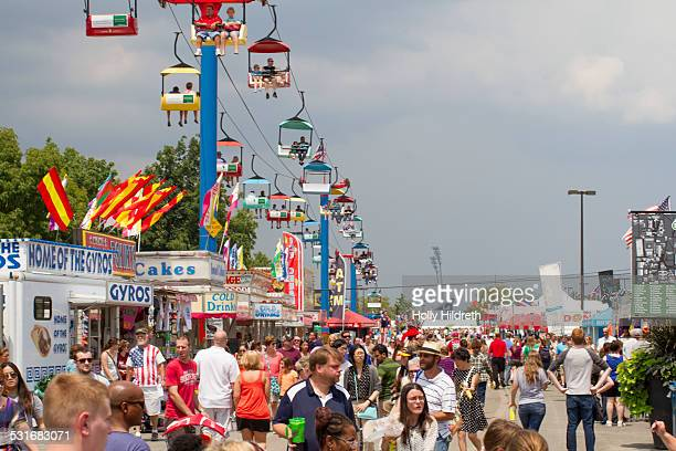 Visitors flood the midway at the Ohio state fair States in the Midwest take particular pride in their state fairs and they're often considered THE...