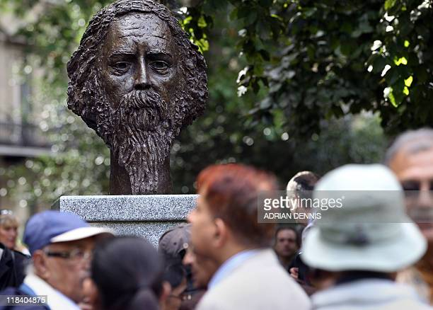 Visitors gather around a sculpture of Indian poet and philopspher Rabindranath Tagore after Britain's Prince Charles unveiled the bust in London on...