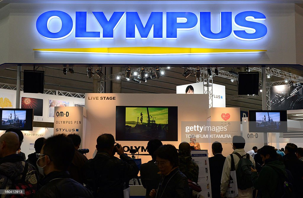 Visitors gather at the Olympus booth during the CP+ (CP plus) photo imaging show in Yokohama on January 31, 2013. Around 96 companies are participating in the exhibition with some 70,000 visitors expected in the four-day-long event.