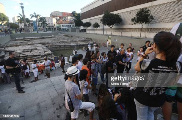 Visitors gather at the Valongo slave wharf entry point in the Americas for nearly one million African slaves on July 15 2017 in Rio de Janeiro Brazil...