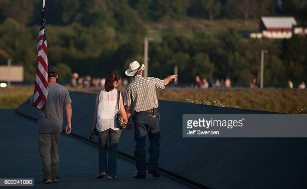 Visitors gather before a luminaria service at the Flight 93 National Memorial on September 10 2016 in Shanksville Pennsylvania Tomorrow marks the...