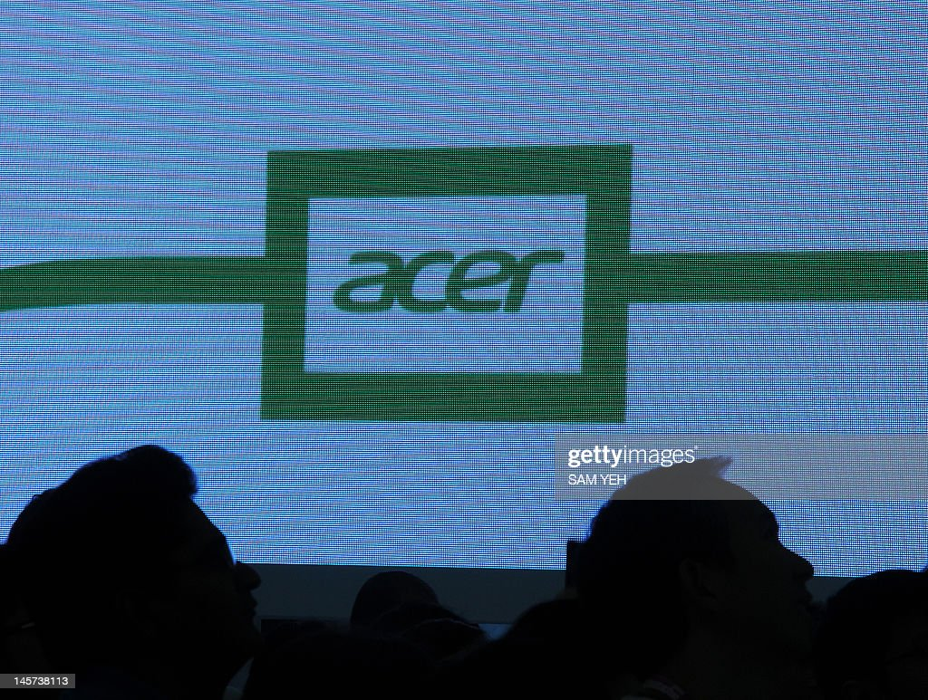 Visitors gather beside an Acer logo during the Computex 2012 in Taipei on June 5, 2012. Computex is Asia's leading IT trade fair. AFP PHOTO / Sam YEH