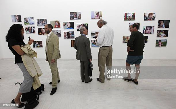 Visitors gather for the opening exhibition of photographer Danny Goldfield's 'NYChildren' project at the grand opening of the Park51 community center...