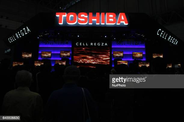 Visitors gather in front of booths of Toshiba at the Energy Market Liberalisation Expo in Tokyo Japan March 2 2016 Toshiba Corp has been facing a...