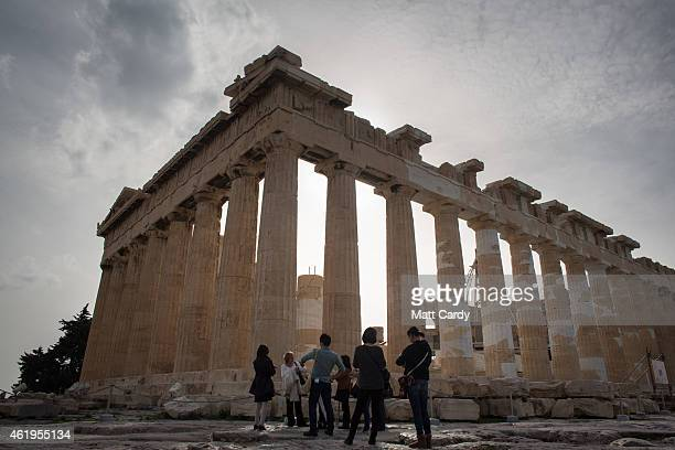 Visitors gather in front of the Acropolis ahead of Greece's general election on January 22 2015 in Athens Greece According to the latest opinion...