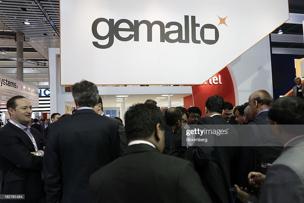 Visitors gather in the Gemalto NV pavilion at the Mobile World Congress in Barcelona, Spain, on Wednesday, Feb. 27, 2013. The Mobile World Congress, where 1,500 exhibitors converge to discuss the future of wireless communication, is a global showcase for the mobile technology industry and runs from Feb. 25 through Feb. 28. Photographer: Simon Dawson/Bloomberg via Getty Images