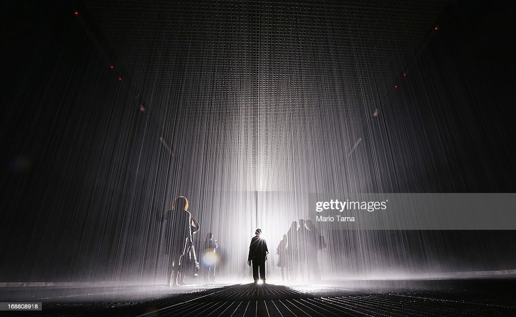 Visitors gather in the new 'Rain Room' installation at the Museum of Modern Art in Manhattan on May 15 2013 in New York City The 5000 squarefoot...