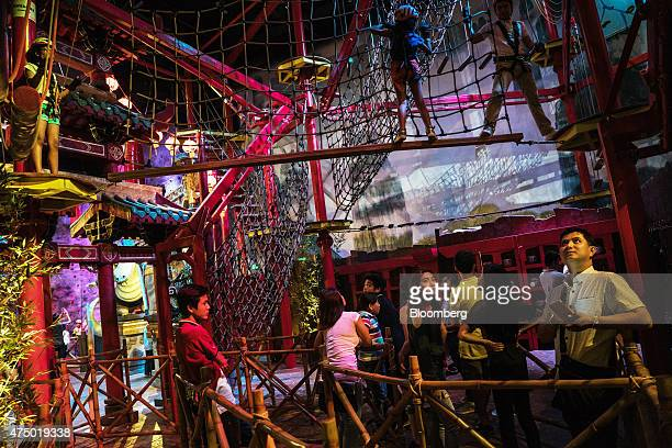 Visitors gather in the 'Wall of Destiny' at the Dreamworks Dreamplay entertainment center at the City of Dreams Manila casino resort operated by...