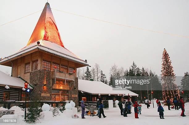 Visitors gather outside of Santa's office at Santa Claus Village on the Arctic Circle near Rovaniemi Finland on December 21 2002 Santa Claus village...