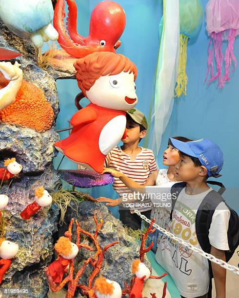 Visitors gaze at clay model of the animation movie 'Ponyo on the Cliff by the Sea' at an exhibition of the movie in Tokyo on July 17 2008...
