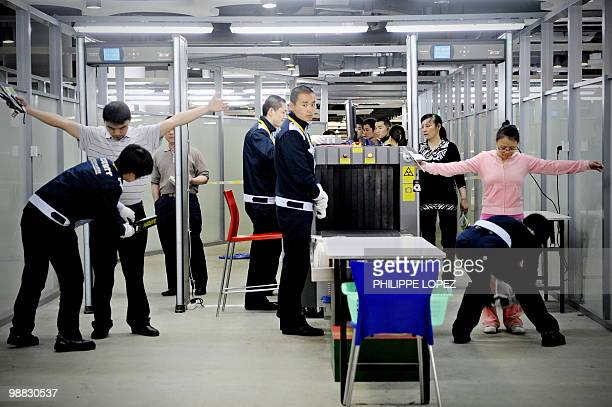 Visitors go through a security check to enter the site of the World Expo 2010 in Shanghai on May 4 2010 Attendance at Shanghai's World Expo fell far...