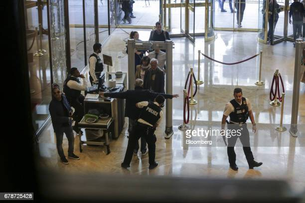 Visitors go through security inside the lobby of Trump Tower in New York US on Thursday May 4 2017 President Donald Trumpreturns Thursday with all...