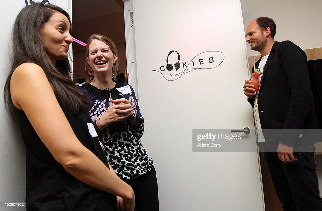 Visitors have drinks in a conference room named Cookies, one of several in the office named after local dance clubs, on September 26, 2012 at the official opening party of the Google offices in Berlin, Germany. Although the American company holds 95% of the German search engine market share and already has offices in Hamburg and Munich, its new offices on the prestigious Unter den Linden avenue are its first in the German capital. The Internet giant has been met with opposition in the country recently by the former president's wife, who has sued it based on search results for her name that she considers derogative. The European Commission has planned new data privacy regulations in a country where many residents opted in to have their homes pixeled out when the company introduced its Street View technology.