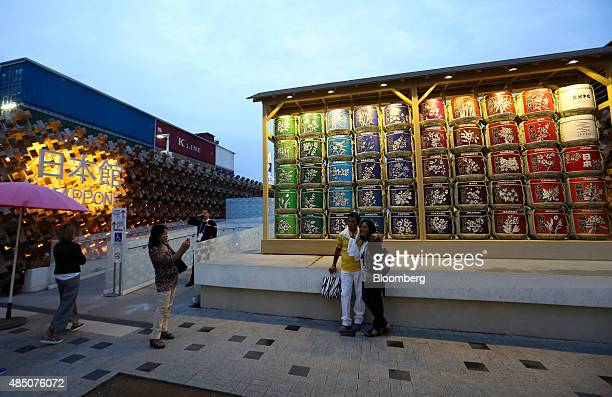 Visitors have their photograph taken at the entrance to the Japan pavilion at the Expo 2015 exhibition in Milan Italy on Sunday Aug 23 2015 Milan won...