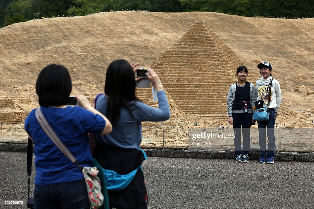 Visitors have their photographs taken in front of a Pyramid at Tobu World Square theme park on May 01, 2016 in Nikko, Japan. Tobu World Square contains over a hundred 1:25 scale models of famous buildings, including World Heritage Sites, complete with 140,000 1:25 miniature people and receives visitors from around the world.