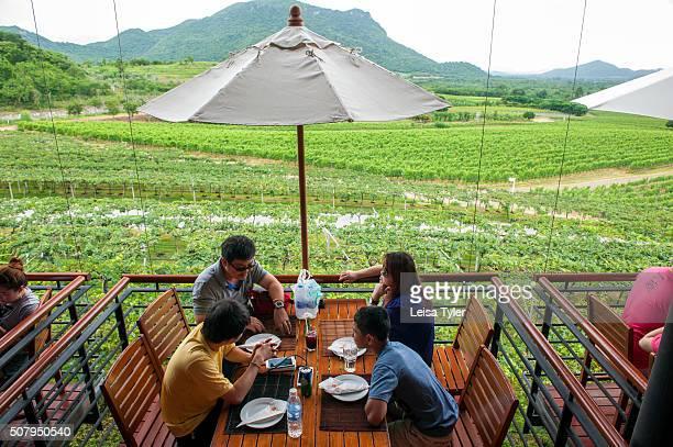 Visitors having lunch at Hua Hin Hills Vineyard located in a verdant valley 40 kilometres inland from Hua Hin Thailand